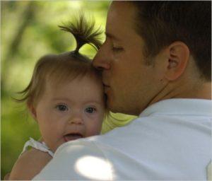Dad Kisses Child Graphic